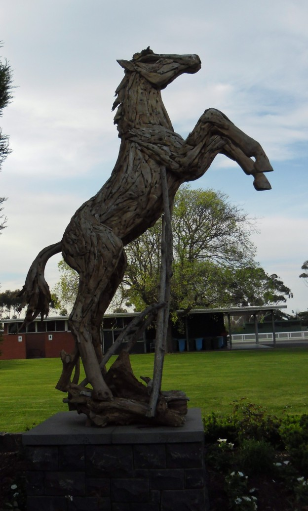 the wooden statue at the gate of geelong racing club.